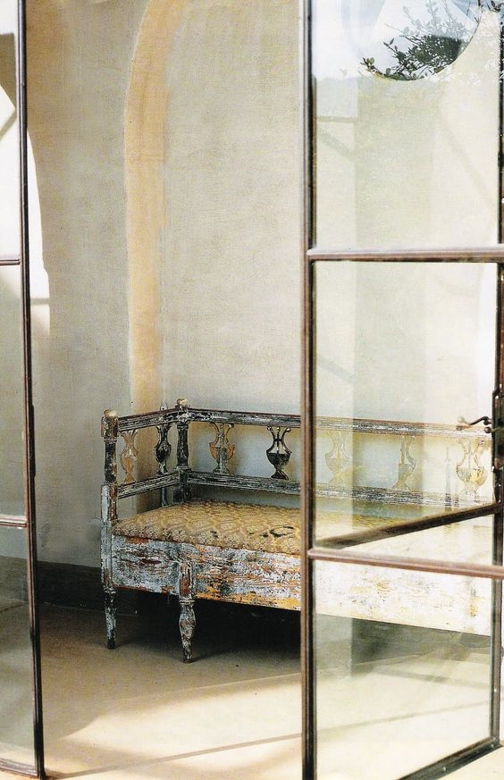 glass and iron doors - weathered bench - image via Elle Decor Italia - as seen on linenlavenderlife com