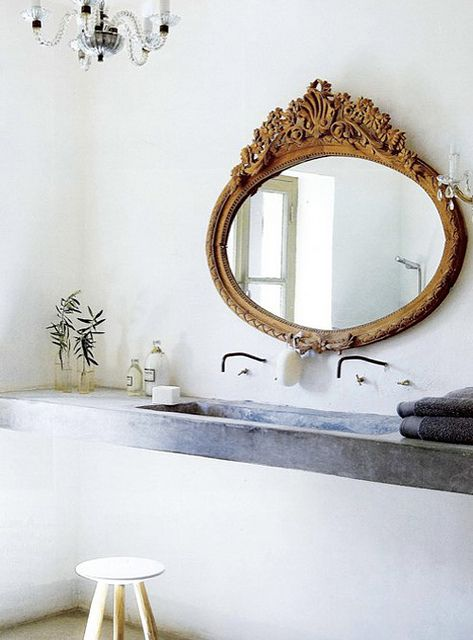 carved wood mirror, minimalist bath design via flickr - as seen on linenlavenderlife com